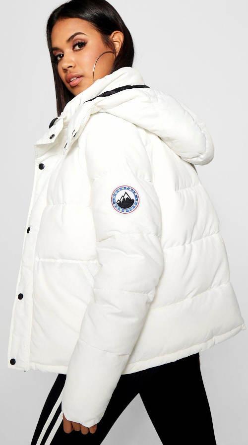 Bílá prošívaná dámská bunda s kapucí